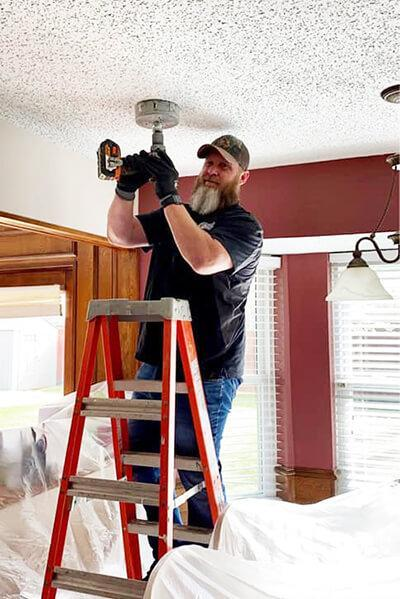 Chris Duggins, Electrician, installing lighting for residential customer